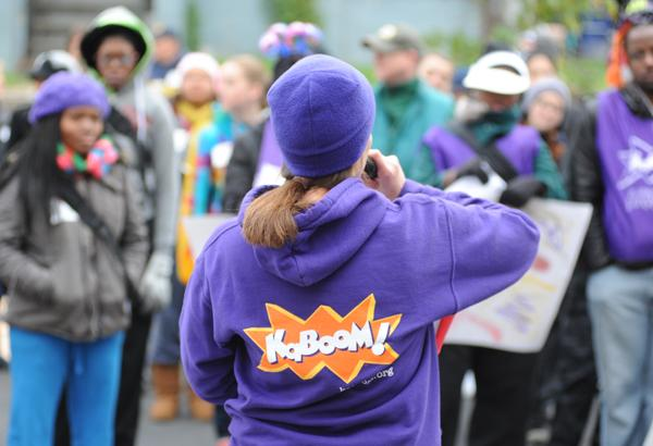 Kathryn Lusk, project manager from KaBOOM!, readies more than 250 volunteers from the Washington Redskins, Wells Fargo, the Salesforce Foundation, the District Alliance for Safe Children (DASH), organizers from KaBOOM! and residents of the D.C. community for a playground build on the grounds of DASH's Cornerstone Housing Facility on Saturday, Nov. 3.
