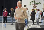 A volunteer takes in the scene at the Waterford precinct on the morning of Election Day.