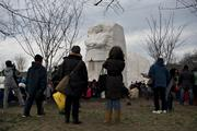 People gather around the Martin Luther King Jr. Memorial on the National Mall during the presidential inauguration on Monday.
