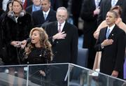 President Barack Obama holds his hand over his heart as singer Beyonce performs the national anthem during the presidential inauguration ceremony Monday in Washington.