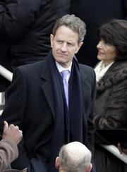 Treasury SecretaryTimothy Geithner arrives during the presidential inauguration in Washington on Monday.