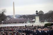 The Washington monument stands as attendees and members of the U.S. Air Force gather during the second inauguration of President Barack Obama on Monday.
