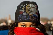 Shantrese Davis from New Orleans wears a hat with an image of President Barack Obama to keep warm on the National Mall Monday.