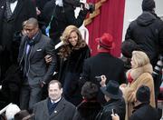 Musician Jay-Z and his wife Beyonce arrive on the platform outside the U.S. Capitol before the inauguration of President Barack Obama.