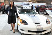 Tamara Darvish, vice president of DARCARS Automotive Group, poses with the Chevrolet Corvette — she has her 2014 Stingray on order.