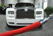 The 2013 Rolls-Royce Phantom Drophead Coupe is on display at the 2013 Washington Auto Show behind the red velvet rope — fitting for an automobile worth nearly half a million dollars.