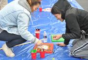 Many panels were custom painted by volunteers and staff at the playground build on the grounds of DASH's Cornerstone Housing Facility on Saturday, Nov. 3.