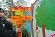 Painted murals, sandboxes, picnic tables and a signpost were installed in another area of the property at the playground build on the grounds of DASH's Cornerstone Housing Facility on Saturday, Nov. 3.