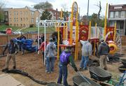Finishing touches and the last of the concrete was mixed for the playground build on the grounds of DASH's Cornerstone Housing Facility on Saturday, Nov. 3.