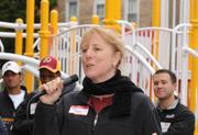 DASH Executive Director Peg Hacskaylo thanks the crowd for all their hard work before the ribbon cutting for the playground build on the grounds of DASH's Cornerstone Housing Facility on Saturday, Nov. 3.
