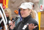 Wells Fargo's Anna Powell thanks her crew and all the volunteers at the playground build on the grounds of DASH's Cornerstone Housing Facility on Saturday, Nov. 3.
