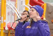 Kathryn Lusk, project manager from KaBOOM!, thanks all the volunteers and prepares for the ribbon cutting at the playground build on the grounds of DASH's Cornerstone Housing Facility on Saturday, Nov. 3.