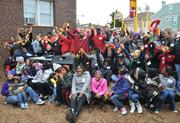 Volunteers, residents and staffers celebrate cutting the ribbon for the playground build on the grounds of DASH's Cornerstone Housing Facility on Saturday, Nov. 3.