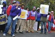 Kathryn Lusk, project manager from KaBOOM!, organizes the Team Leaders for a playground build on the grounds of DASH's Cornerstone Housing Facility on Saturday, Nov. 3.