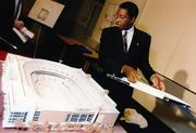 The late architect Paul Devrouax displays a model of MCI Center.