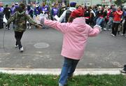 KaBOOM! team leaders and volunteers enjoy the breakdancing before getting to work on the playground build on the grounds of DASH's Cornerstone Housing Facility on Saturday, Nov. 3.