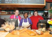 The staff at South Street Under — Tess Goodier, Kristal Cook and Matt Lower (left to right) — in Leesburg were ready to serve on Monday during Hurricane Sandy.