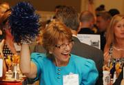 Kathy Mason of the Berkeley County Development Authority shakes her pompoms at the Washington Business Journal's 2012 Best Places to Work awards event at the Ritz Carlton in Tysons Corner, VA