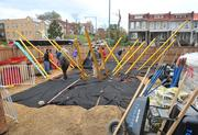 Playground construction begins early on Saturday, Nov.3 on the grounds of DASH's Cornerstone Housing Facility.