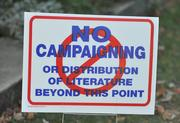 A sign outside the Waterford precinct directs supporters on the distribution of campaign literature.
