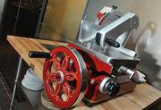 A Berkel meat slicer sits adjacent to a glass-enclosed meat room at the Range restaurant in Chevy Chase.