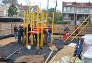 Progress continues on the playground build on the grounds of DASH's Cornerstone Housing Facility on Saturday, Nov. 3.