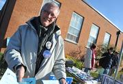 An Obama supporter hands out campaign literature in the Waterford precinct.