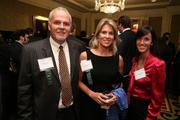From GCS, Inc., Robert Cope, left, and Claire Townsend, with Christina Ryan from Hartman Executive Advisors at the Fastest Growing Companies Awards.