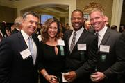 Joe Alvarez, left, from NOS, with Marlene Gardner, Adrian Massiah and Tom McGuire, all from WorkSpaces LLC at the Fastest Growing Companies Awards.