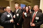 From Zenetex LLC, Doug Rember, from left, Mike Roscoe, Cindy Randall, and Dennis England at the Fastest Growing Companies Awards.