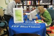 Vision screening at JBS International's annual Health & Wellness Fair