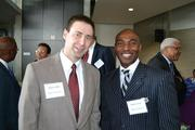 From Bank of America, Brian Griffin, left, with Rickey Green.