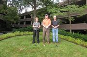 MBP's Lynn DeWolfe, vice president of corporate services, Blake Peck president & chief operating officer, and Dave Palfrey, project manager, play golf outside the company's office.