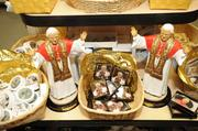 Washington had about five months to prepare for Pope Benedict's visit in 2008, which attracted visitors from all over the country and created a big market for souvenirs like these available at the shops in the Basilica of the National Shrine of the Immaculate Conception in Northeast D.C.