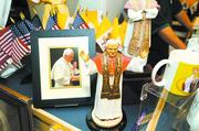 The pope's visit was expected to increase sales of merchandise licensed for the occasion and sold at the shops in the Basilica of the National Shrine of the Immaculate Conception.