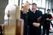 Washington Archbishop Donald Wuerl, left, and David M. O'Connell, president of the Catholic University of America, admire a chair made for Pope Benedict XVI at the university center. The pope would later use the chair during an address on Catholic education at the university.