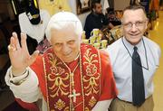 Dennis Zeigler, manager at the time of The National Shrine gift shop at the Basilica, poses with a cutout of Pope Benedict XVI.
