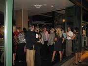 The crowd was able to take advantage of the very summer-like weather, and mingle both inside and out.