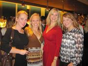 From left, Mandi Howard of DRT Strategies, yoga instructor Georgia Gerstein, Marybeth Coleman of Jones Lang LaSalle and Windy Shepard of DRT Strategies at the Oct. 23 re-opening of Tony and Joe's Seafood Place.