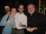 From left, Sarah Hall and Alexander Scott, both of Nugent Design Build, with Fr. Steve Shafran of Don Bosco Cristo Rey High School at the Oct. 23 re-opening of Tony and Joe's Seafood Place.