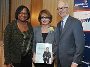Colleen Taylor of Capital One and Alex Orfinger of the Washington Business Journal present award to honoree Lynne Breaux at the 2012 Women Who Mean Business event.