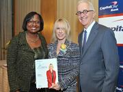 Colleen Taylor of Capital One and Alex Orfinger of the Washington Business Journal present award to honoree Lisa Brown at the 2012 Women Who Mean Business event.