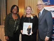 Colleen Taylor of Capital One and Alex Orfinger of the Washington Business Journal present award to honoree Kimberley Fritts at the2012 Women Who Mean Business event.