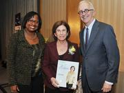 Honoree Barbara Harmanaccepts award from Colleen Taylor of Capital One and Alex Orfinger of the Washington Business Journal at the 2012 Women Who Mean Business event.