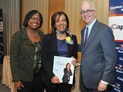 Honoree Bahija Jallalaccepts award from Colleen Taylor of Capital One and Alex Orfinger of the Washington Business Journal at the 2012 Women Who Mean Business event.