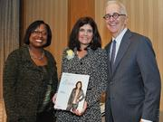 Honoree Lisa Martin accepts award from Colleen Taylor of Capital One and Alex Orfinger of the Washington Business Journal at the 2012 Women Who Mean Business event.