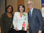 Honoree Diana Mayhew accepts award from Colleen Taylor of Capital One and Alex Orfinger of the Washington Business Journal at the 2012 Women Who Mean Business event.
