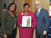 Honoree DeRionne Pollard accepts award from Colleen Taylor of Capital One and Alex Orfinger of the Washington Business Journal at the 2012 Women Who Mean Business event.