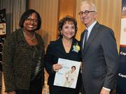 Colleen Taylor of Capital One and Alex Orfinger of the Washington Business Journal present award to honoree Julie Rosenthal at the 2012 Women Who Mean Business event.