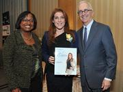 Colleen Taylor of Capital One and Alex Orfinger of the Washington Business Journal present award to honoree Jayne Sandman at the 2012 Women Who Mean Business event.